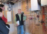 Bruce explains the in floor heating system to the homeowners