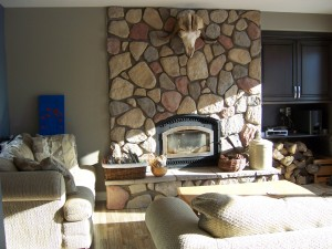 A woodburning fireplace provides renewable heat
