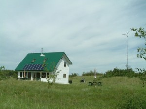 Our Off-Grid House with Wind Turbine and Solar Array
